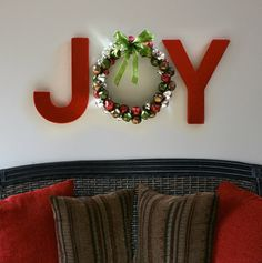 Painted letters from a craft store and a jingle bell wreath. @ Heart-2-HomeHeart-2-Home