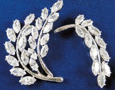 "This magnificent set of pins were a wedding gift to Jackie from Joseph and Rose Kennedy, her new parents-in-law. The pins came with fixtures that allowed Jackie to wear them in her hair - approximately 2 1/4"" and 2""."