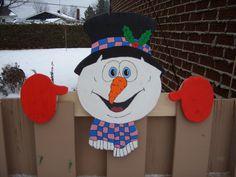 tête de snow man sur cloture