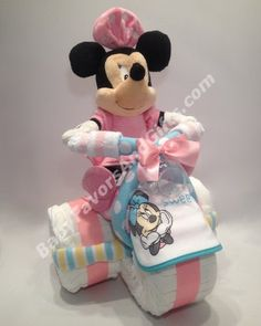 Minnie Mouse Tricycle Diaper Cake http://babyfavorsandgifts.com/diaper-cakes-baby-girl-c-3_22.html