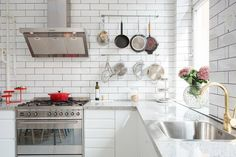 gold faucet and subway tile in the kitchen
