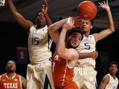 Texas Longhorns guard Javan Felix, center, looks to pass as Washington Huskies guard Dejounte Murray, right, and forward Noah Dickerson defend in the first half during the 2015 Battle 4 Atlantis in the Imperial Arena at the Atlantis Resort in the Bahamas.  Kevin Jairaj, USA TODAY Sports