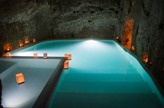 A candlelit spa inside a dark cave at the Domus Civita in Bagnoregio, Italy