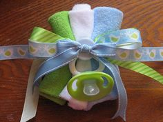 you could attach a pin to it & make mommy & daddy wear it as a baby shower corsage.creative!