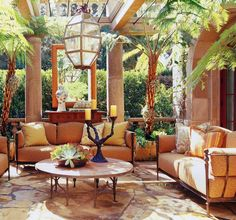 Tuscan Patio idea. Love the glass ceiling and the large mirror hanging between the pillars.