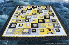 Tamarack Shack quilted this cute black and yellow quilt. Wonderful use of color!