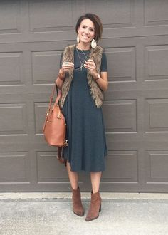 furry vest over a dress with booties and leather earrings