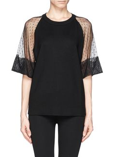 Feminine grace and poise come in the form of this laced sleeve number from See by Chloé. Imbuing a basic top with a sensual edge, this lightly dotted piece is appealing with its flattering peek-a-boo effect.