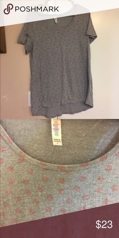 Lularoe Classsic T pink polka dots Large LuLaroe Classic T gray with pink dots. Size large   *** CHECK OUT  ALL MY OTHER LISTINGS BY CLICKING ON MY PROFILE. TONS OF NEW AND USED STUFF***   **** If you would like to combine any of my listings or would rather bundle different ones together message me *** LuLaRoe Tops Tunics