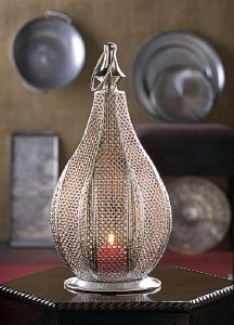 Look no further for a stunning candle accessory that will instantly increase the style factor in any room. Our Metal Rattan Lantern features a stunning pear-shaped design with an intricate rattan-style woven pattern that will enhance the beauty of cand Unique Wedding Centerpieces, Lantern Centerpiece Wedding, Lantern Wedding, Table Centerpieces, Silver Lanterns, Hanging Lanterns, Lantern Candle Holders, Candle Lanterns, Votive Holder