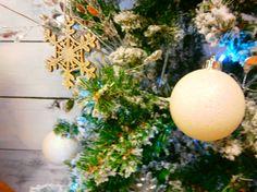 Matt white bauble on a tree