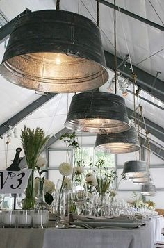 old metal buckets re used as hanging light shades, the size is well in proportion with the table decor.