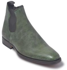 Casual and Trendy Green Distressed Leather Boots Unique distressed leather style leather boots These ankle boots have the most dapper exterior The green color combined with snakeskin gives a chic vibe Perfect height and sturdy dimensions for utmost class The outsoles are dark brown for a contrasting feel The surface is