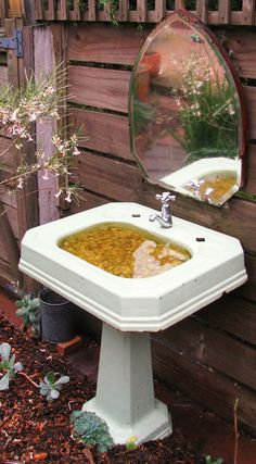 "Old bathroom sink as a cool bird bath ... have to be careful about mosquitoes though, and those stones in the bottom would make it tough to clean ... maybe use on of those river stone ""tiles"" from homedepot/lowe's that has a mesh backing ... could be removed in one piece for cleaning."