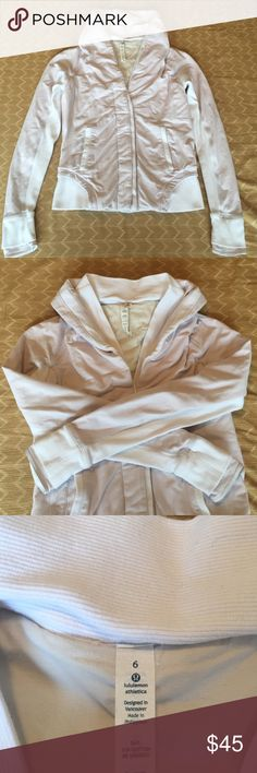 RARE Lululemon Sweater Cardigan Jacket Sz 6 Great rare style jacket from lululemon. Light blush pink and white in color. Has high neck collar than can also be folded down. Has thumbholes with cuff over. Two front pockets, front button closure. Pleated detail on back. No piling, has slight wear but no significant stains. GUC. Lots of life left! No trades. lululemon athletica Jackets & Coats