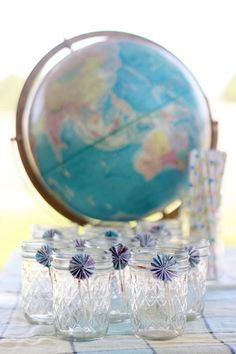 Love the little rosette flowers tied onto glass jars {made out of maps}. Cute way to dress up drinks! Via Kara's Party Ideas- www.KarasPartyIdeas.com. A site full of party ideas!