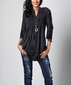 A pin-tucked bodice accents the playful cut of this relaxed tunic crafted from lightweight, stretch-infused fabric that offers supreme comfort.Note: This is a one-of-a-kind item; prints may vary.Made for zulilyModel: 5' 8'' tall; 33'' chest; 24'' waist; 35'' hipsSize S: 33'' long from high point of shoulder to hem; 32'' bustTrue to sizeKnit96% rayon / 4% spandexMachine wash; hang dryImportedShipping note: This item is made to order. Allow extra time for your special find to ship.