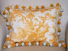 Toile pillow with ball trim