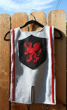 Remember when I showed you these arm bracers I made for a Knight's costume? Well, I finished up the tunic a few days before the Knigh...