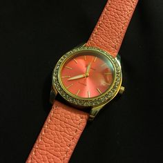 Rhinestone watch Give an additional touch of style to your outfit with the womens bracelet watch.  Rhinestone around the front  Stainless Steel Back Adjustable strap color coral with a glass front Accessories Watches