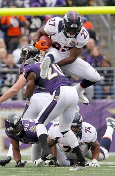 Knowshon Moreno elevates over Ravens S Ed Reed on a 20-yard pickup. Broncos vs. Ravens 12-16-2012.