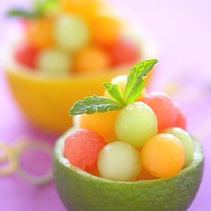 Fun melon cups!! GREAT idea for summer!! (maybe try them frozen?) This with a yummy drink on a hot summer day sound awesome :)