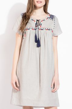 Casual and feminine embroidered dress | summer outfit idea | tassel detal