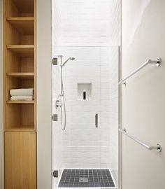 Bathroom- skylight in shower and tiles with glass door.