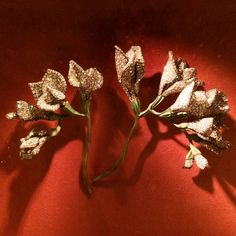 Freesia Brooches by JAR, 2010. Diamond, bronze, silver, and gold. Photo by Cheryl Kremkow.