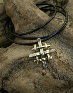 """A striking, woven version of the """"Jerusalem Cross"""". Finsihed on a strand of blackleather. Pendant Measures: All Sterling. Cross Jewelry, Metal Jewelry, Chris Brown Tattoo, Jerusalem Cross, Cross Art, Chunky Jewelry, Cross Paintings, Knights Templar, Polymer Clay Projects"""