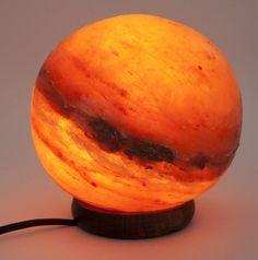 Globe Salt Crystal Lamp- super cool, looks like a planet!! Definitely a fan of the dimmer switch as well :)