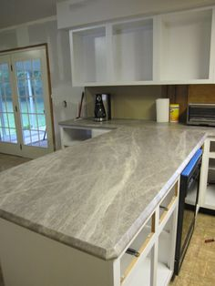 Scott & Allie show off their kitchen redesign and renovation featuring Formica® 180fx® laminate Soapstone Sequoia.