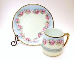 Tea cup and saucer with rose heart garland