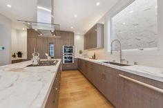 A massive marble island in the kitchen provides a space for informal dining.  I LOVE this kitchen!!!!