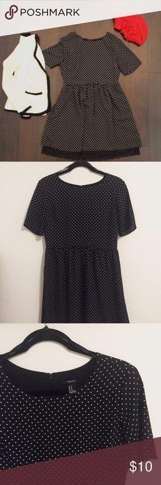 Black Dress w/ White Polka Dots A classic & feminine take on the polka dot dress with a bottom black lace trim. Back zipper. Knee-length. Forever 21 Dresses Mini