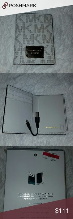 84afae3c384285 Selling this New Michael Michael kors phone charger wallet on Poshmark! My  username is: Michael Kors