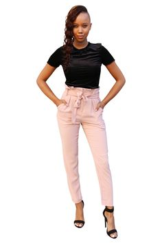 Our best-selling paperbag high waist pants fit slightly loose but still tapered. Perfect for working and going out. Comes in black or pink. - 100% Polyester. - Hand wash cold. - Fits true to size (see