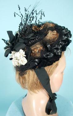 c. 1880's Victorian Bonnet of Black Velvet, Black Raffia, Straw Raffia, Jet Beads, Black Netting with Flowers and Ribbons