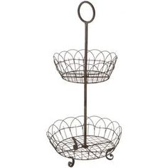 """Bring a touch of charm to your indoor or outdoor decor with this wire stand, showasing 2 scalloped tiers for displaying fresh fruit or vibrant accents. Product: Serving standConstruction Material: MetalColor: Rusted metalFeatures: Two tierDimensions: 24"""" H x 14"""" Diameter Shipping: This item ships small parcelExpected Arrival Date: Between 04/18/2013 and 04/26/2013Return Policy: This item is final sale and cannot be returned"""