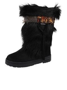 BearPaw Kola Cow hair for the foot area and Goat's fur for the shaft of the boot. Also available in White fur.