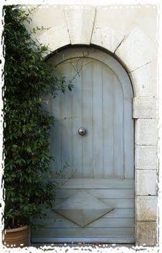 Grey-blue arched door