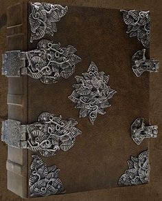 """GREENMAN's GRIMOIRE © Brahms Bookworks, Tampa, Florida).  """"Medallion modeled after The Florentine man relief by Michaelangelo."""" Includes 400 sheets of parchment pages."""