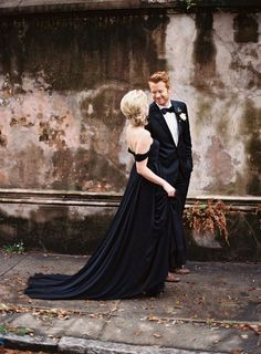Classic black suit and off the shoulder black dress. Winter wedding or winter event inspiration.
