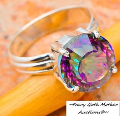 10 CARAT MYSTIC TOPAZ STERLING SILVER RING SIZE 8 1/2 is going up for auction at  12am Sun, May 26 with a starting bid of $1.
