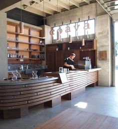Coava Coffee Shop with a large retail space behind the counter. It's the perfect place to display your coffee mugs.