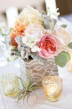 mixed pastel floral arrangement with lace wedding centerpiece