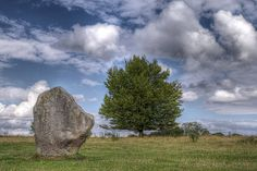 Avebury Henge    Avebury is a Neolithic henge monument containing three stone circles which is located around the village of Avebury in Wiltshire, south west England. Unique amongst megalithic monuments, Avebury contains the largest stone circle in Europe, and is one of the best known prehistoric sites in Britain.Constructed around 2600 BCE, during the Neolithic, or 'New Stone Age', the monument comprises a large henge, surrounded by a bank and a ditch. Inside this henge is a large outer…