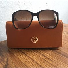 HP Tory Burch 'Rounded Square' sunglasses Tortoiseshell sunglasses by Tory Burch! Style is called 'Rounded Square'. Has logo on both sides. Comes with leather case, logo on case has a little scuff on it. These are in great condition! There's a tiny scratch on the right lens (like 2 cm) but I didn't notice it until I held it in a very bright light! Kind of a Celine 'Audrey' style! Tory Burch Accessories Sunglasses