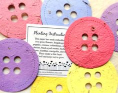 Plantable Paper Baby Shower Buttons ** Plant the buttons, they grow! ** Plantable paper confetti buttons contain a mix of perennial and annual flower seeds - they can be planted to grow. Color choices are listed below. Pack of 100 plantable confetti buttons in your choice of color/s Buttons are about 1 inch in size (size of a quarter). ............COLOR CHOICES.............. White, cream, beige, tan, brown, pale yellow, sunshine yellow, dark/mustard yellow, butterscotch, light bab...