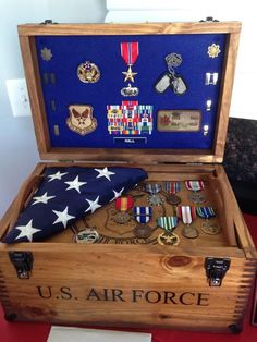 "Testimonial by Julie Mills Hall - ""My husband retired this weekend and his box was a hit!! We laid the flag they folded and some of his medals on the tray for show at his party, but we did opt for the flag holder inside and it looks great!! So many compliments! Thank you, we love it!!!"""